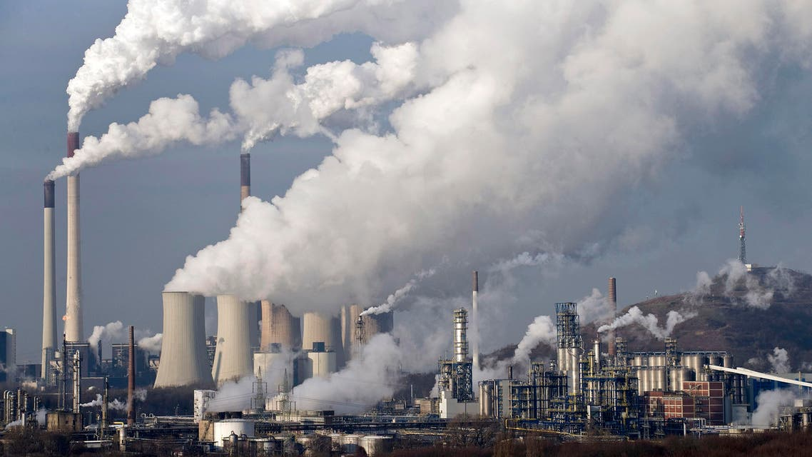 In this Dec. 16, 2009 file photo, steam and smoke rises from a coal power station in Gelsenkirchen, Germany. AP