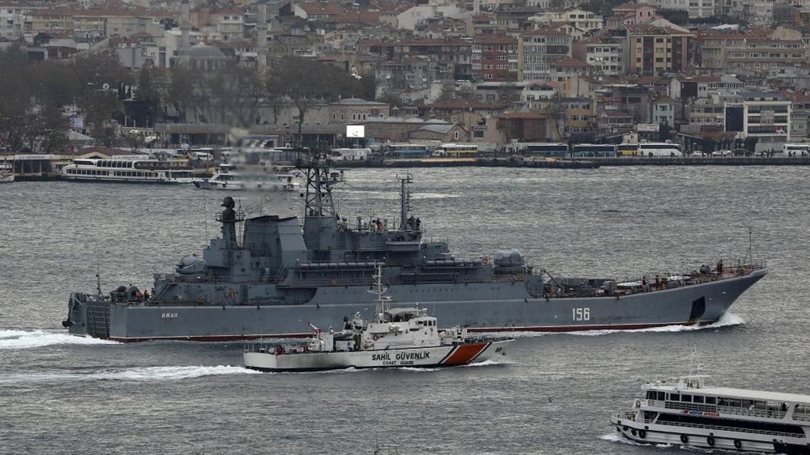 The Russian Navy large landing ship Yamal is escorted by a Turkish Navy Coast Guard boat as it sets sail in the Bosphorus, on its way to the Mediterranean Sea. (File photo: Reuters)