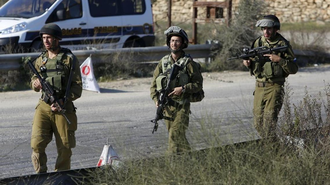 Israeli soldiers patrol near the scene where a Palestinian, who the Israeli military said attempted to ram his car into Israeli soldiers, was shot dead at a checkpoint near Hebron. (File photo: Reuters)
