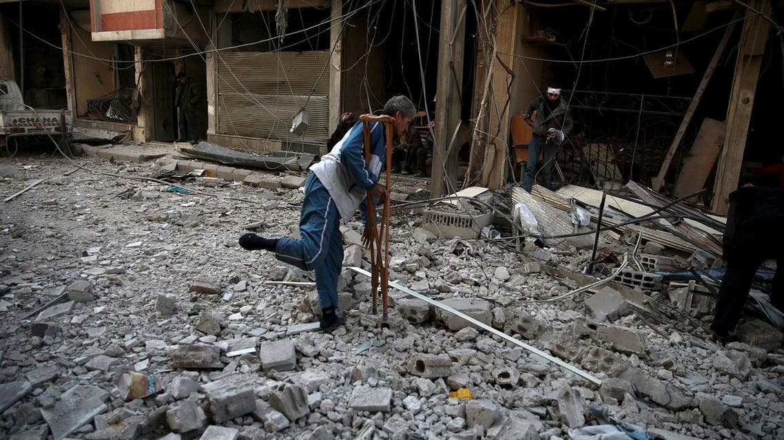 Men search for belongings at a site hit by missiles in the Douma neighborhood of Damascus, Syria December 13, 2015. Reuters)