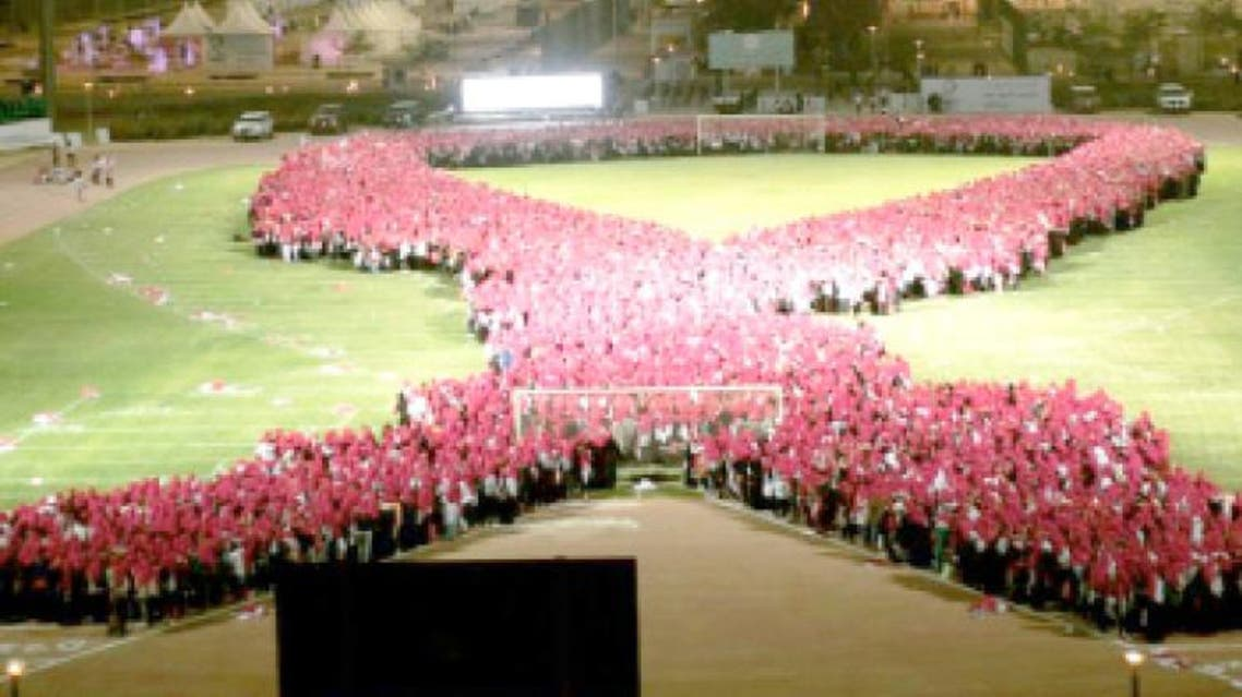Wearing pink scarves, 10,000 Saudi women stood hand-in-hand in the football stadium at Princess Nourah Bint Abdulrahman University at the conclusion of a day-long fair to raise awareness about women's health in Riyadh. (Photo: Saudi Gazette)