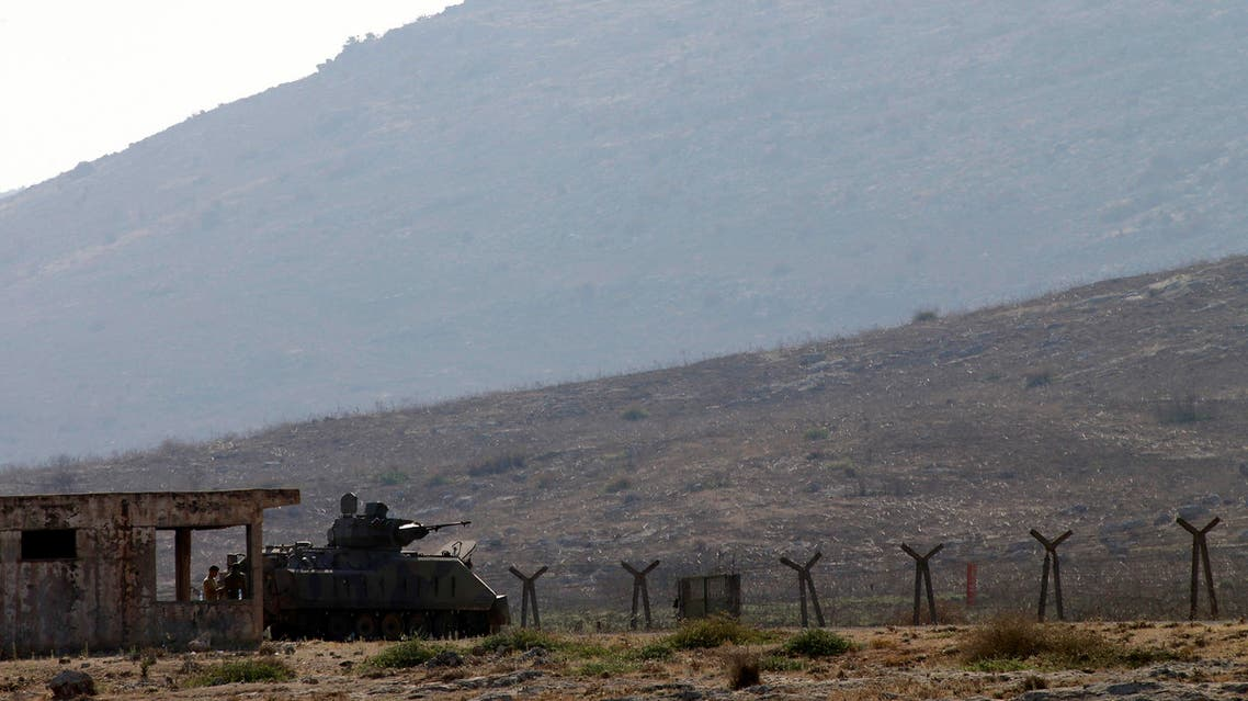 A Turkish soldier stands near an armored vehicle at the border with Syria near Cilvegozu, Turkey Tuesday, Sept. 3, 2013. AP