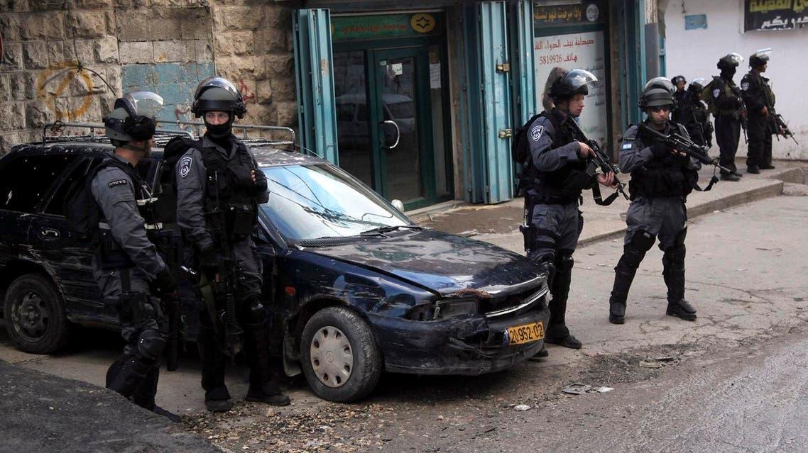 Israeli policemen stand guard in the Palestinian refugee camp Shuafat in Jerusalem. (AP)