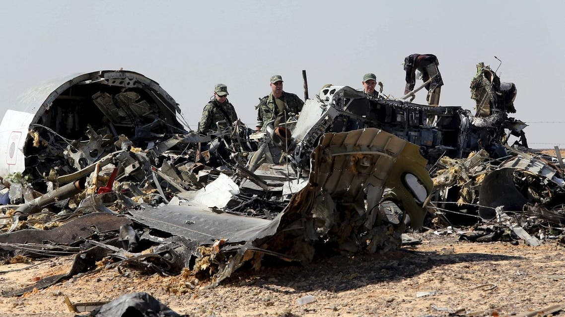 File photo shows Russian military investigators near the debris of a Russian airliner at the site of its crash at the Hassana area in Arish city, north Egypt. (Reuters)