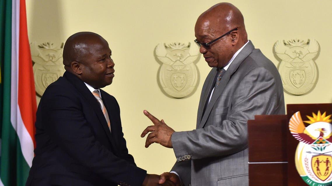 South African president Jacob Zuma, right, congratulates newly sworn-in Finance Minister David Van Rooyen, in Pretoria, South Africa, Thursday, Dec. 10, 2015.