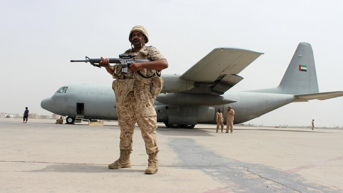 Soldier from the United Arab Emirates stands guard next to a UAE military plane at the airport of Yemen's southern port city of Aden. (Reuters)