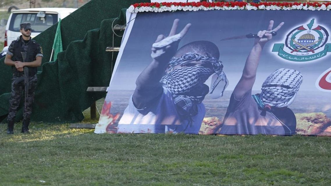 A member of the Hamas security forces stands guard during a Hamas women's rally in Gaza. (Reuters)