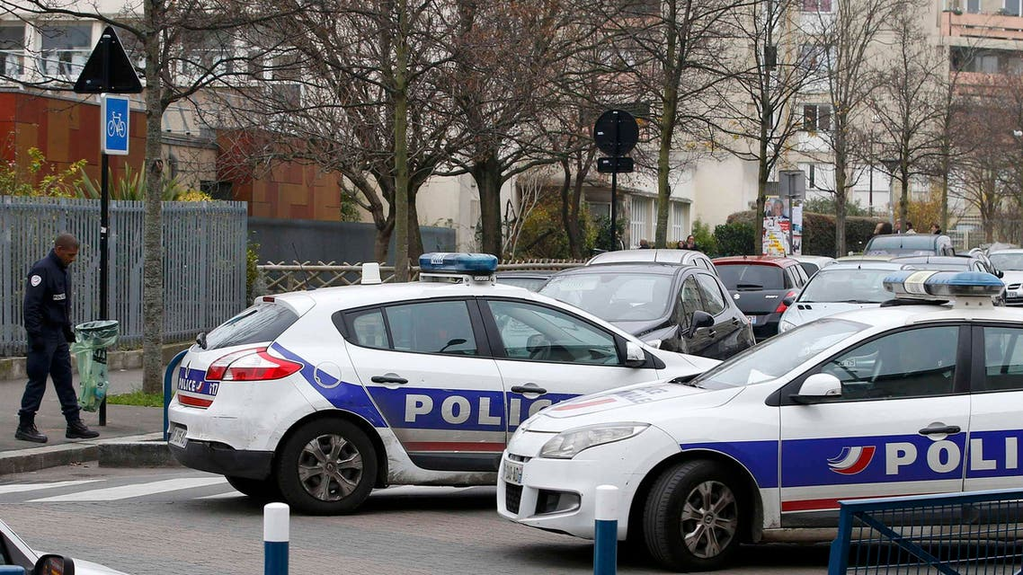 French police stand in front of the nursery school where a hooded man claiming to be acting for Islamic State attacked a teacher with a knife in Aubervilliers, near Paris, France, December 14, 2015. REUTE