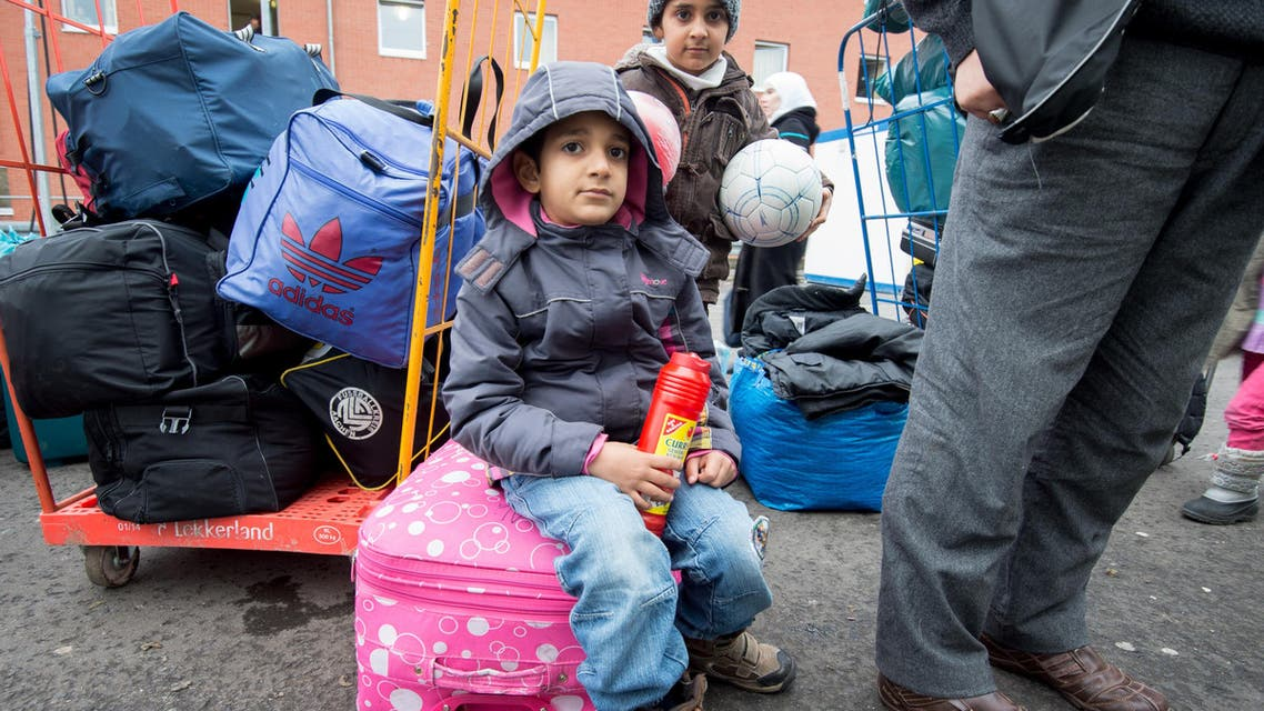 Two refugee children wait amongst luggage for registration at the Hesse state Initial Reception Center in Giessen, Germany, Wednesday Dec. 2, 2015. (AP)efugee children wait amongst luggage for registration at the Hesse state Initial Reception Center in Giessen, Germany, Wednesday Dec. 2, 2015. (AP)ren wait amongst luggage for registration at the Hesse state Initial Reception Center in Giessen, Germany, Wednesday Dec. 2, 2015. (AP)