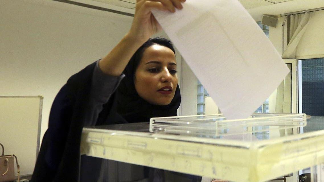 Saudi women vote at a polling center during the municipal elections, in Riyadh, Saudi Arabia. (AP)