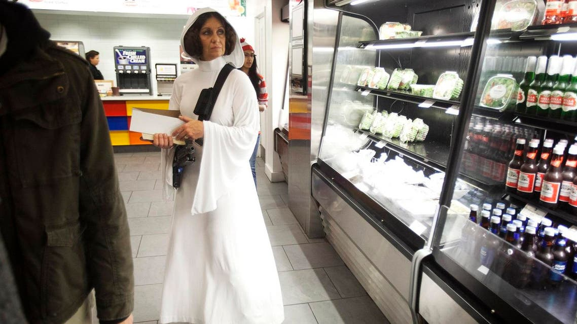File photo of a woman dressed as Princess Leia from Star Wars waiting in line to buy food at ComicCon in New York. (Reuters)