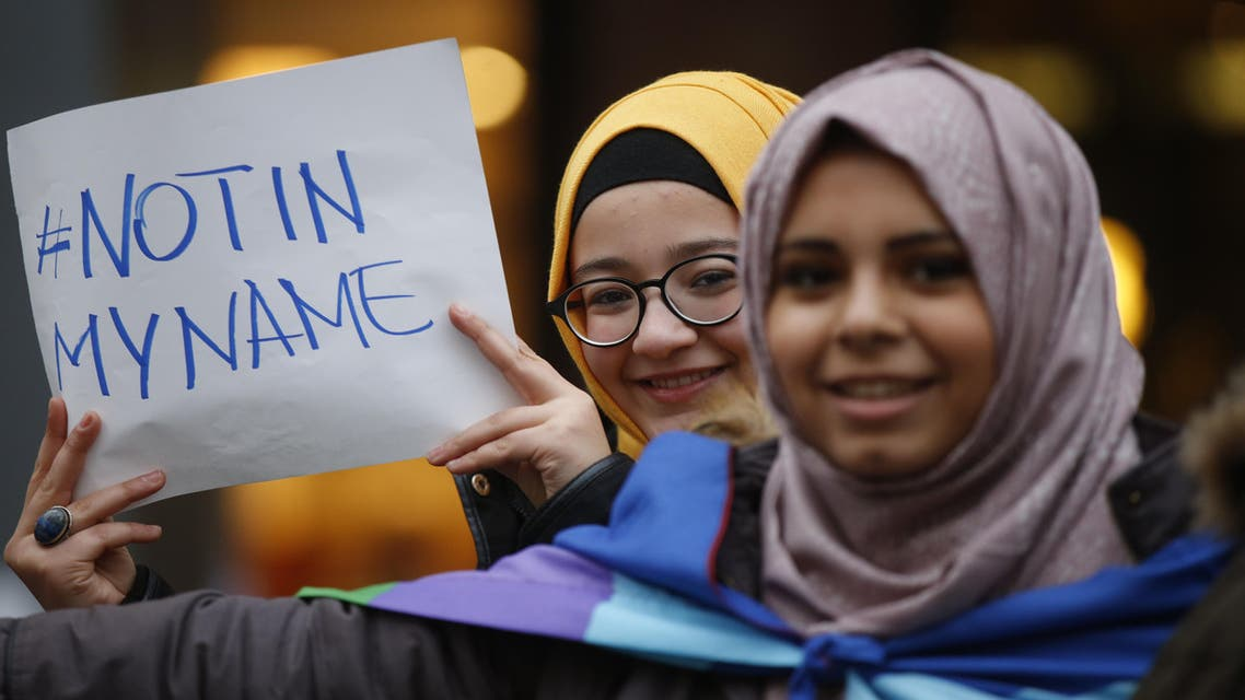 """Two girls hold a sign reading """"Not in my name"""" as members of the Milanese Muslim community gather in downtown Milan, Italy, Saturday, Nov. 21, 2015 to protest against violence. (AP Photo/Luca Bruno)"""