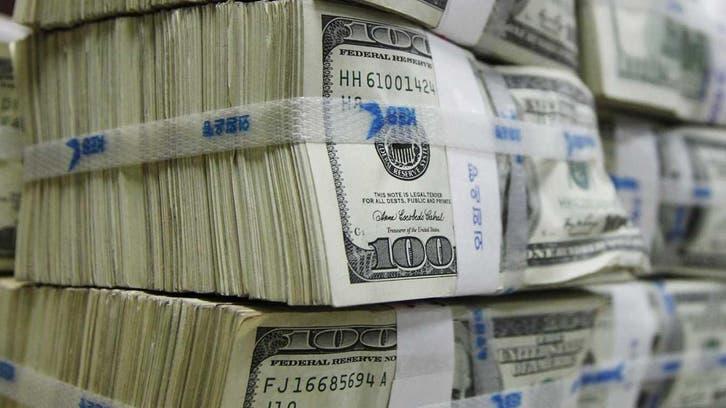 الدولار يرتفع لأعلى مستوى في أسبوعين بعد رفع الفائدة
