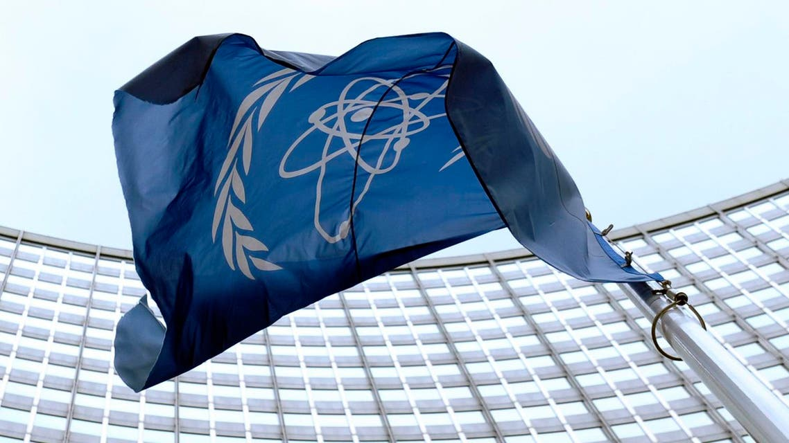The flag of the International Atomic Energy Agency (IAEA) flies in front of the Vienna headquarters at the Vienna International Center. (File photo: AP)