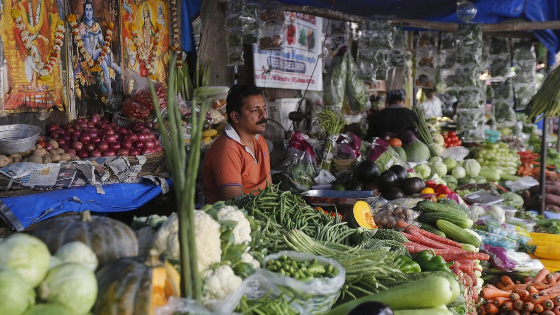 A vegetable vendor waits for customers at his stall in a market in Mumbai, India, December 14, 2015 | Reuters