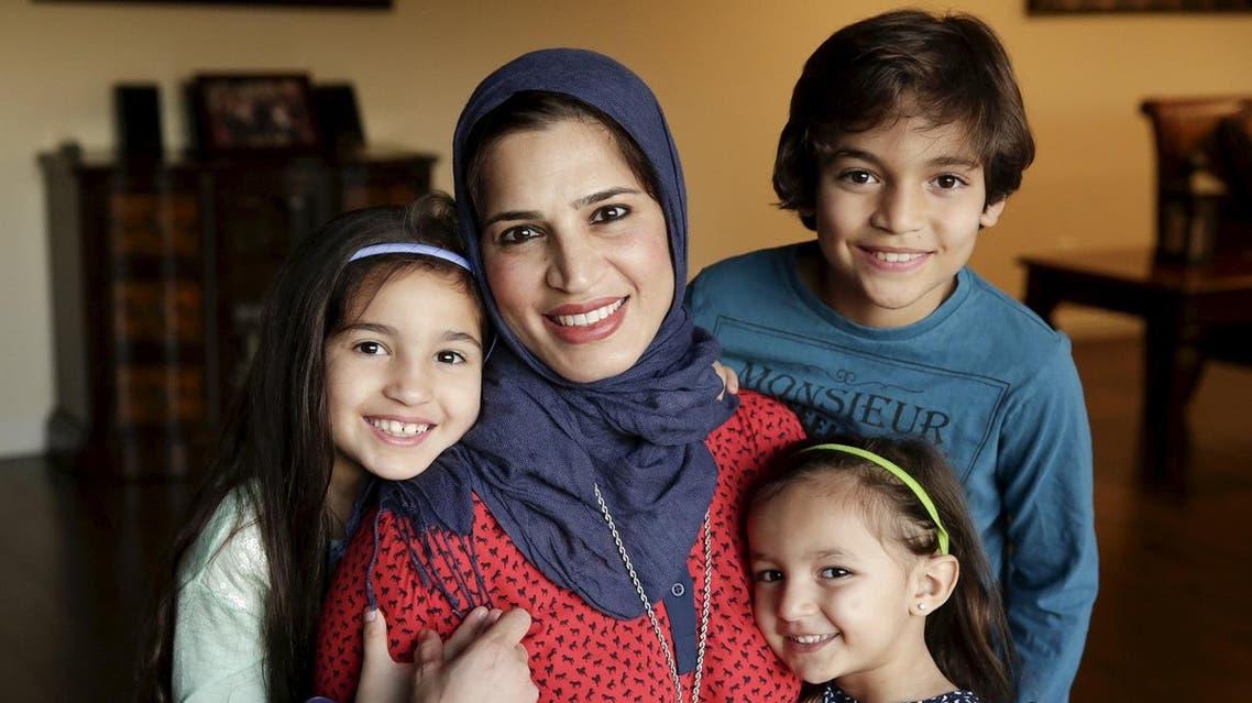 Mirvette Judeh poses for a photo with her children, Ayah Maaytah (L-R), 7, Salma Maaytah, 3, and Rakan Maaytah, 9, at their home in Buena Park, California December 17, 2015. (Reuters)