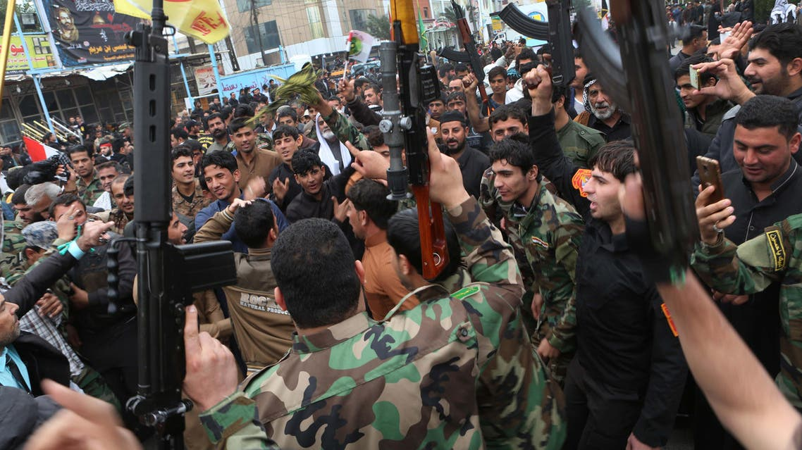 Protesters shout slogans and brandish weapons during a demonstration calling again for the immediate withdrawal of Turkish troops from northern Iraq, in Basra, southern Iraq, Saturday, Dec. 12, 2015.
