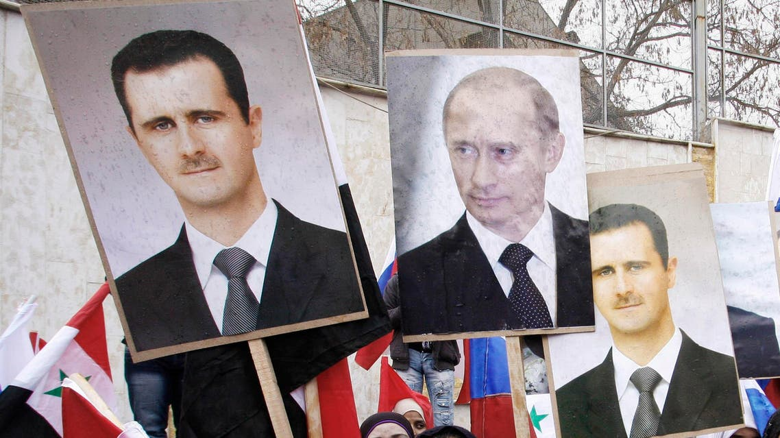 Syrians hold photos of Syrian President Bashar Assad and Russian Prime Minister Vladimir Putin during a pro-Syrian regime protest in front of the Russian embassy in Damascus, Syria, Sunday, March 4, 2012. (AP)