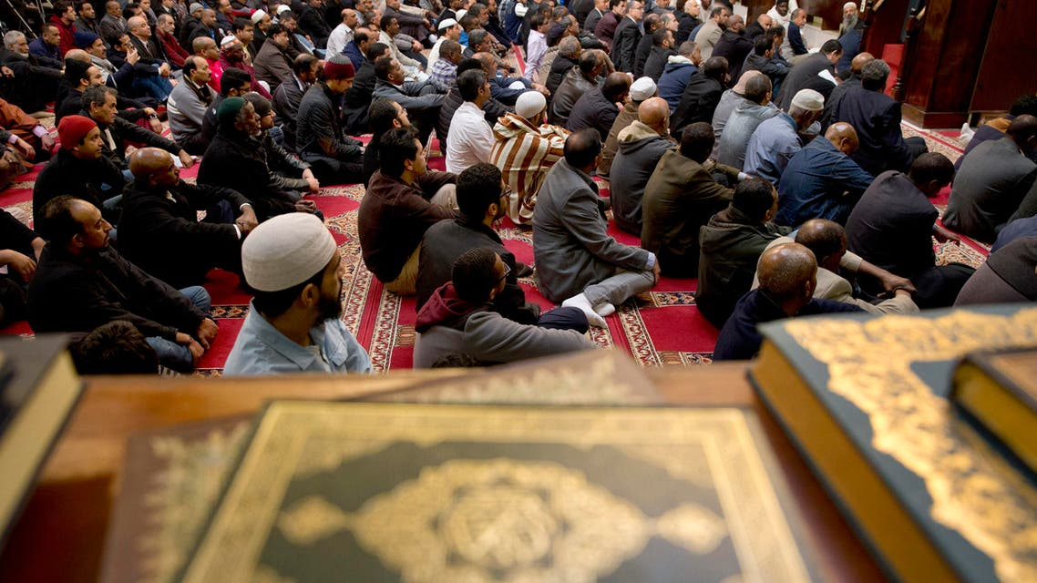 Men listen during a prayer service as Rep. Don Beyer, D-Va., and other local elected officials also attend Friday prayers at Dar al-Hijrah Mosque in Falls Church, Va., Friday, Dec. 4, 2015. ap