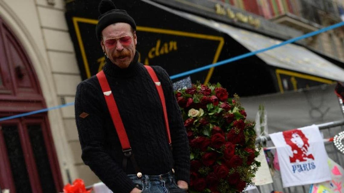 Singer of the US rock group Eagles of Death Metal, Jesse Hughes, pays tribute to the victims of the November 13 attacks in Paris. (File photo: AFP)