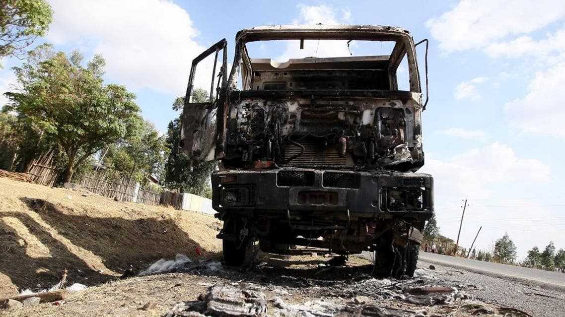The wreckage of a truck torched during recent demonstrations is seen along the road in Holonkomi town, in Oromiya region of Ethiopia December 17, 2015 (Reuters)