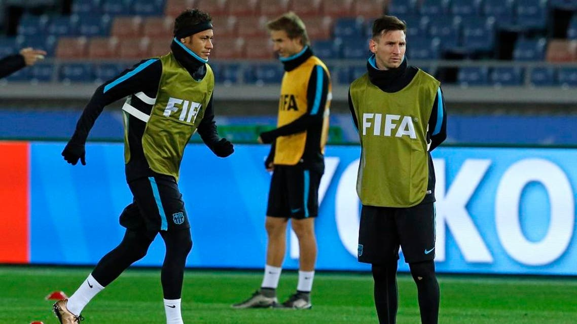 FC Barcelona's Lionel Messi, right, and Neymar, left, work out during a training session, ahead of Sunday's final against Argentine club River Plate at the FIFA Club World Cup soccer tournament in Yokohama, near Tokyo, Saturday, Dec. 19, 2015. (AP)