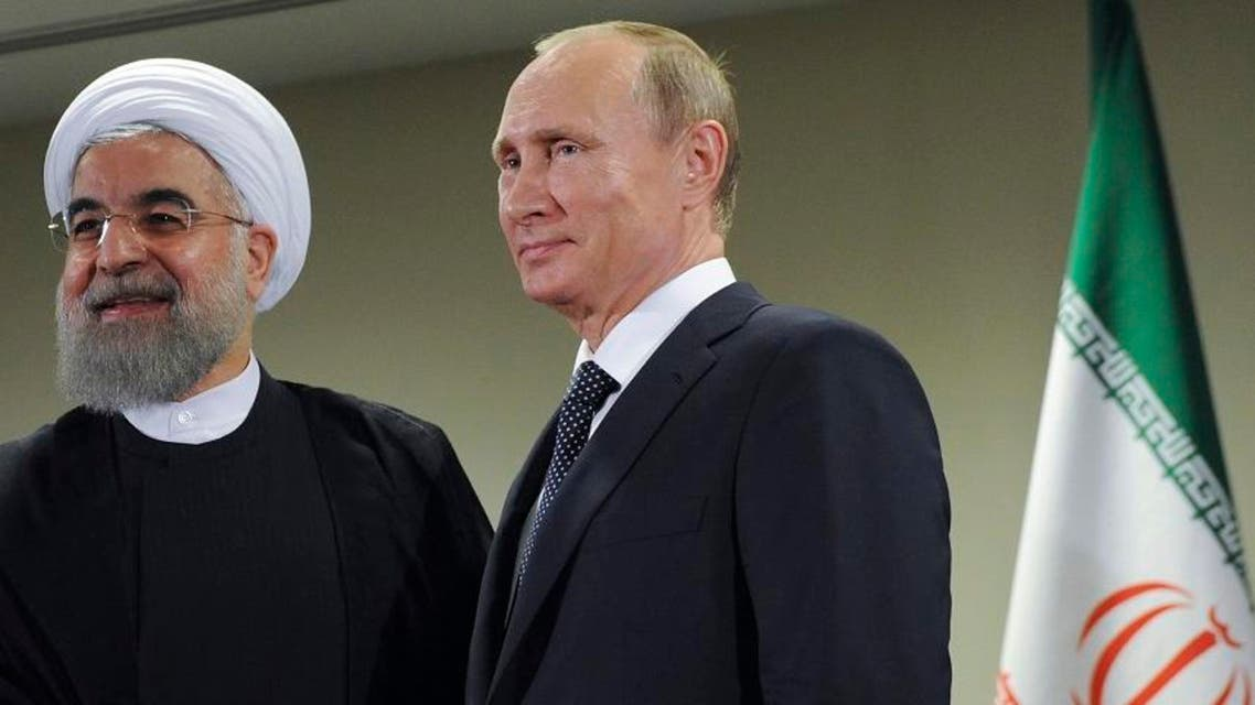 Russian President Vladimir Putin, right, shakes hands with Iran's President Hassan Rouhani after the 70th session of the United Nations General Assembly at U.N. headquarters, New York, Monday, Sept. 28, 2015 (AP)