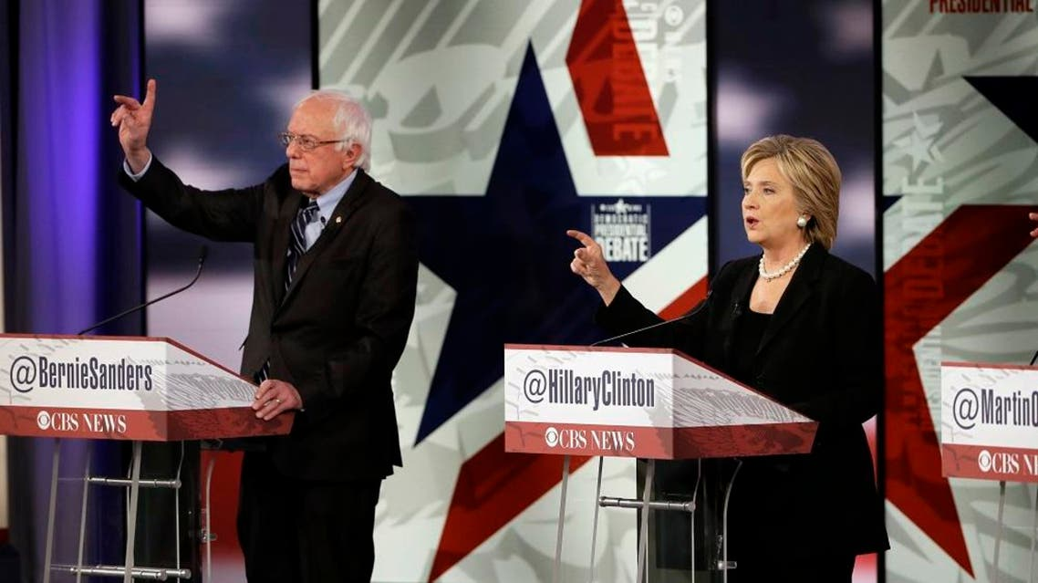 Hillary Rodham Clinton, right, makes a point as Bernie Sanders listens during a Democratic presidential primary debate, Saturday, Nov. 14, 2015, in Des Moines, Iowa