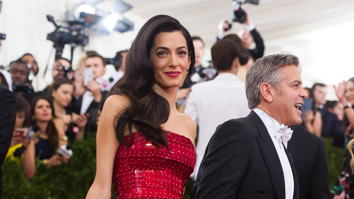 """George Clooney and Amal Clooney arrive at The Metropolitan Museum of Art's Costume Institute benefit gala celebrating """"China: Through the Looking Glass"""" on Monday, May 4, 2015, in New York."""