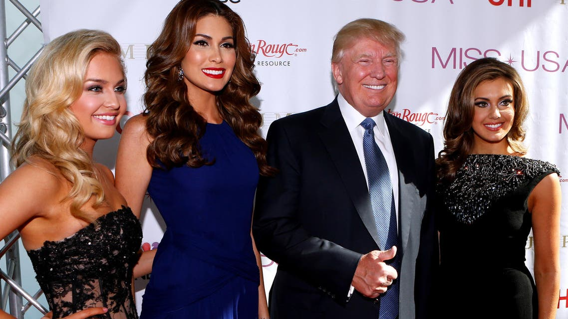 Miss Teen USA 2013 Cassidy Wolf, Miss Universe 2013 Gabriela Isler, Donald Trump, and Miss USA 2013 Erin Brady pose during a red carpet event before the Miss USA 2014 pageant in Baton Rouge, La., Sunday, June 8, 2014. (AP)