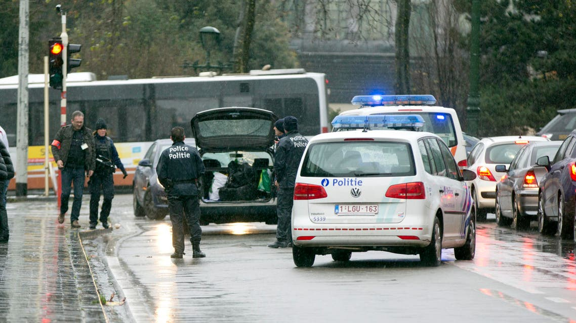 Police search the trunk of a car in Brussels, Saturday, Nov. 21, 2015.  (AP)