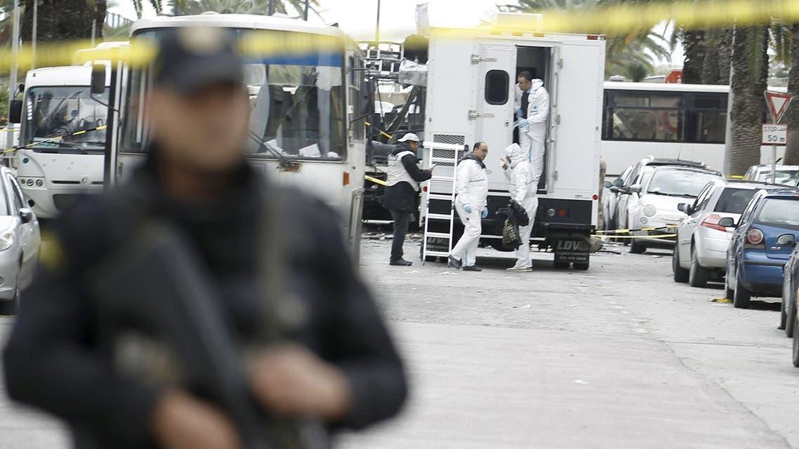 Tunisian forensics police inspect the scene of a suicide bomb attack in Tunis, Tunisia November 25, 2015.