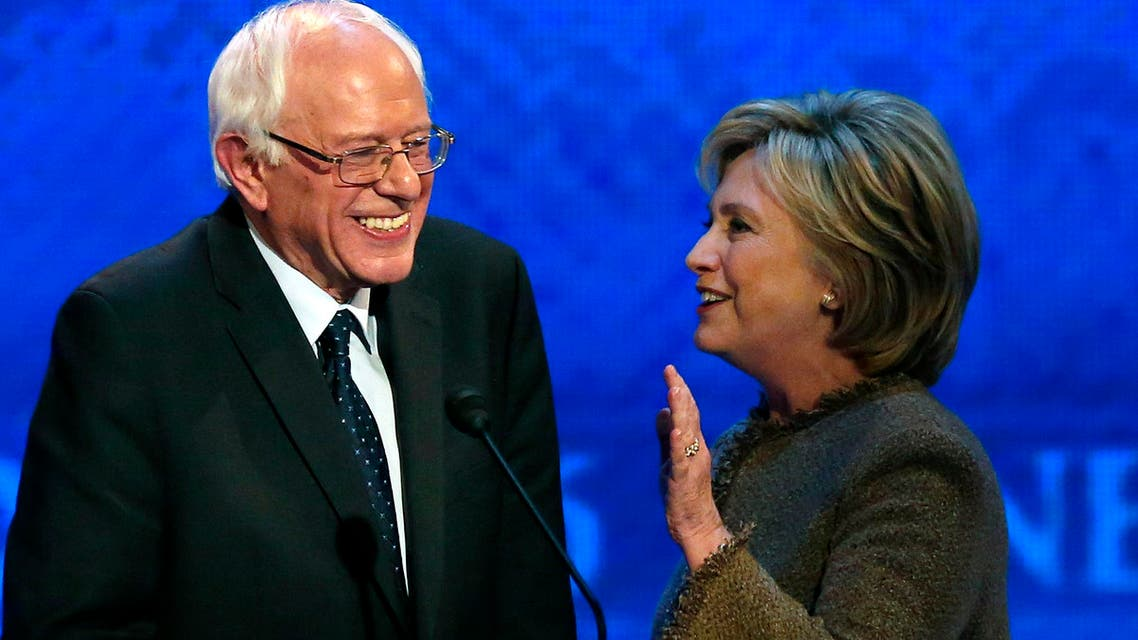 Hillary Clinton, right, speaks to Bernie Sanders during a break at the Democratic presidential primary debate Saturday, Dec. 19, 2015, at Saint Anselm College in Manchester, N.H.  (AP)
