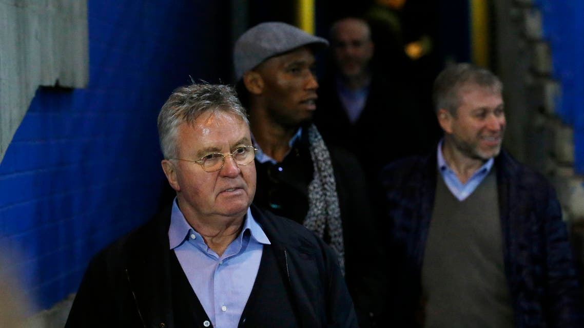 Chelsea's new manager Guus Hiddink, left, club owner Roman Abramovich, right, and former player Didier Drogba, center, walk out pitch side where they shook hands with players and coaching staff warming down after the end of the English Premier League soccer match between Chelsea and Sunderland at Stamford Bridge stadium in London, Saturday, Dec. 19, 2015. (AP Photo/Matt Dunham)
