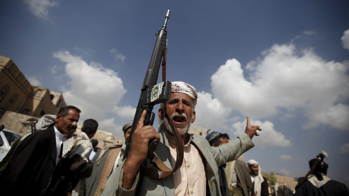 Tribesman loyal to the Houthi movement carries his rifle as he leaves a gathering held to show support for the group, in Yemen's capital Sanaa
