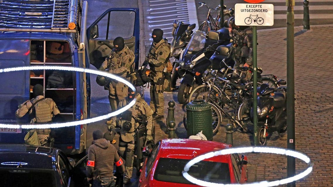 Armed special forces of the police are pictured during searching operations in the Antoine Dansaertstraat - Rue Antoine Dansaert street in the city center of Brussels. (AFP)