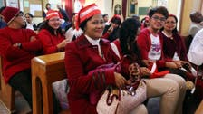 Christmas carols bring solace to Libya's fearful Christians