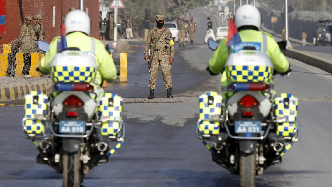 Police on motorcycle patrol a road leading to the Army Public School (APS) during a ceremony to mark the first anniversary of a Taliban attack on the school in Peshawar, Pakistan, December 16, 2015. (Reuters)