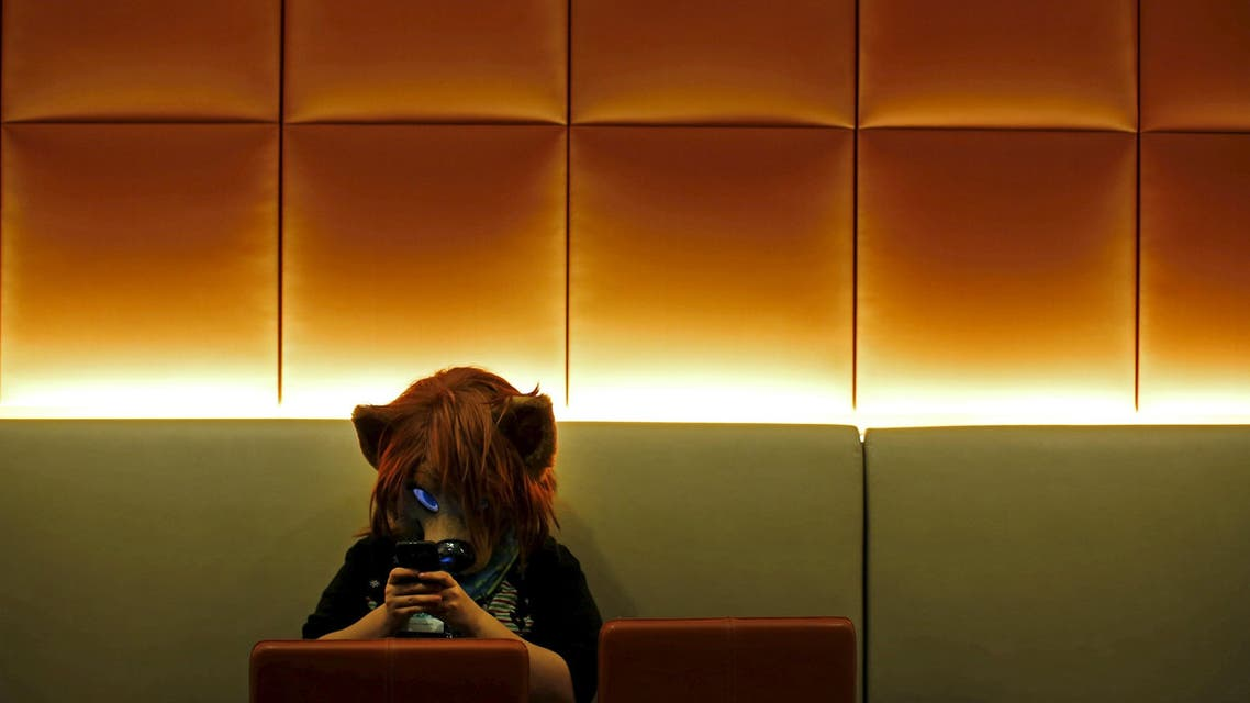 An attendee in 'fursuit' costume looks at her phone at the Midwest FurFest in Chicago. (File: Reuters)