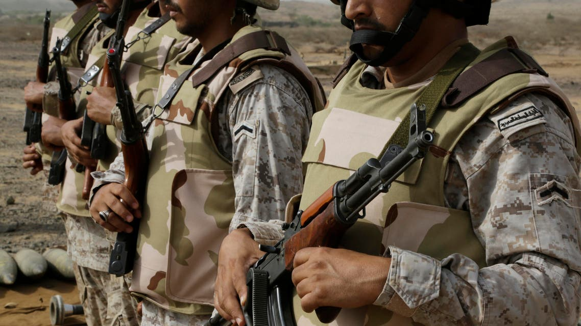 In this photo taken on April 20, 2015, Saudi soldiers with their weapons stand guard at the Yemen border in Jizan, Saudi Arabia.  AP