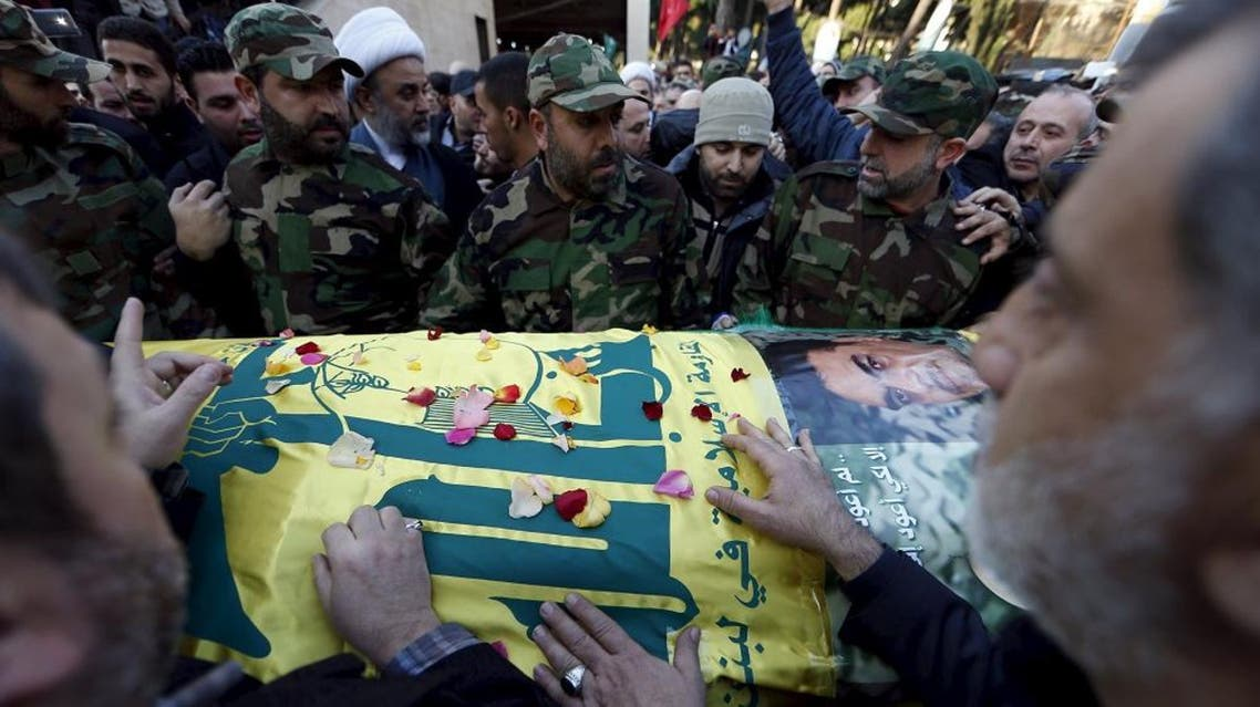 Hezbollah members gather around the coffin of Hezbollah militant leader Samir Qantar during his funeral in Beirut's southern suburbs, Lebanon December 21, 2015. |Reuters