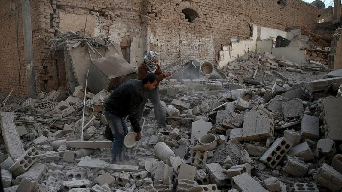 Men search for belongings at a site hit by missiles in the Douma neighborhood of Damascus, Syria December 13, 2015 | Reuters