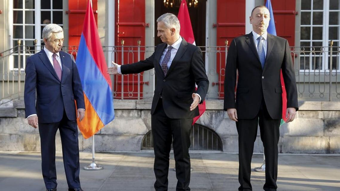 President Serzh Sarksyan of Armenia and President Ilham Aliyev of Azerbaijan meet for talks on the Nagorno-Karabakh conflict at the invitation of Swiss Foreign Minister Didier Burkhalter in Bern, Switzerland December 19, 2015. (Reuetrs)