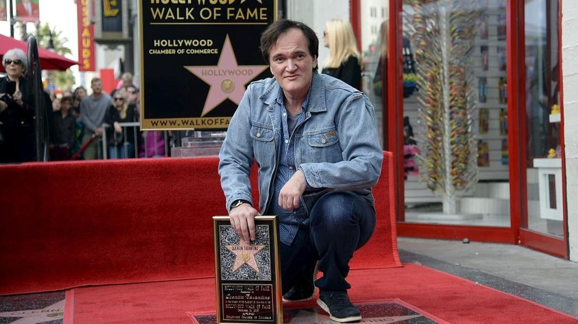 Filmmaker Quentin Tarantino poses after he was honored with a star on the Hollywood Walk of Fame in Hollywood, California December 21, 2015 | Reuters
