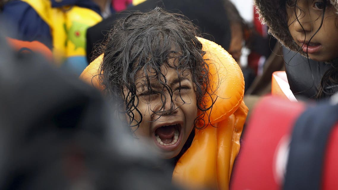 A Syrian refugee child screams inside an overcrowded dinghy after crossing part of the Aegean Sea from Turkey to the Greek island of Lesbos September 23, 2015. REUTERS