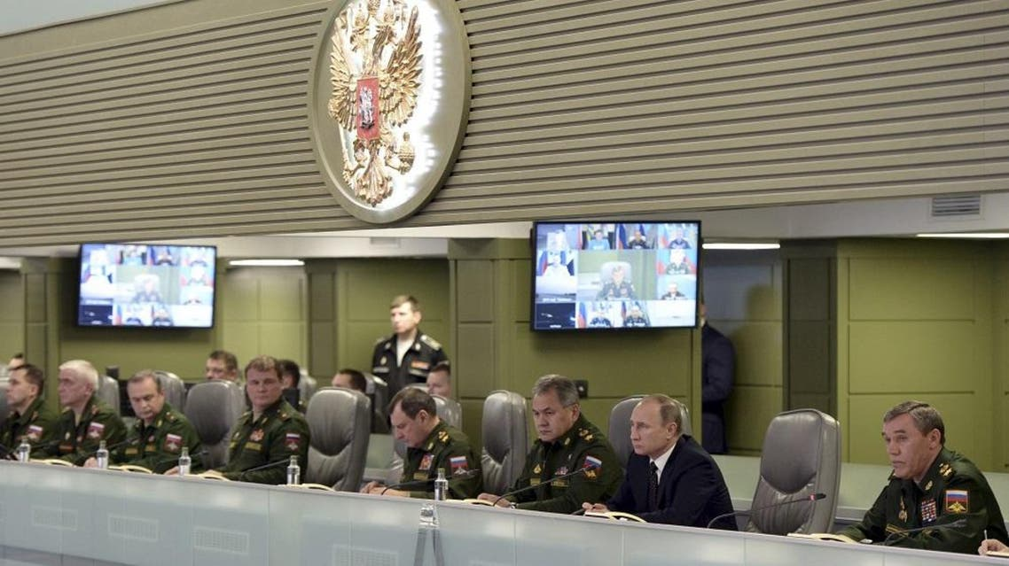 Russian President Vladimir Putin with Defence Minister Sergei Shoigu and armed forces Chief of Staff Valery Gerasimov attend a meeting on Russian air force's activity in Syria at the national defence control centre in Moscow, Russia, November 17, 2015 | Reuters