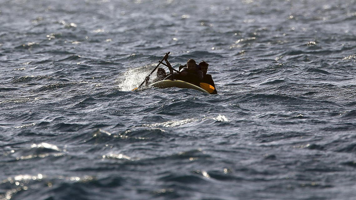 Pakistani immigrants row their engineless dinghy, which was drifting out of control, in rough seas between Greece and Turkey, early May 30, 2015. (REUTERS)