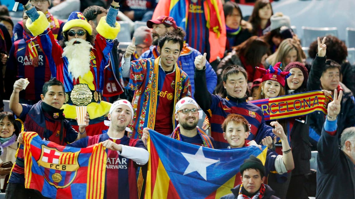 FC Barcelona fans cheer before the start of their final match against River Plate at the FIFA Club World Cup soccer tournament in Yokohama, near Tokyo, Japan, Sunday, Dec. 20, 2015. (AP Photo)