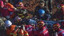 Moment man found alive after 60 hours in China landslide