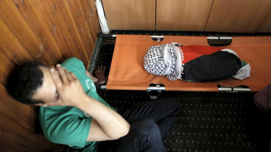 A mourner reacts next to the body of 18-month-old Palestinian baby Ali Dawabsheh, who was killed after his family's house was set to fire in a suspected attack by Jewish extremists in Duma village near the West Bank city of Nablus, in this July 31, 2015. (Reuters)